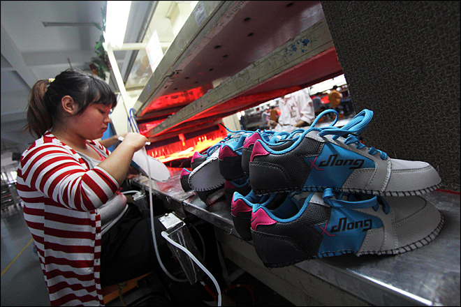 China's factory output rises in sign of recovery