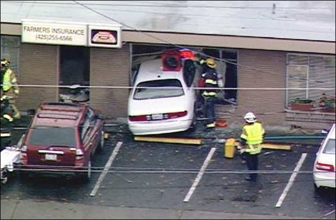 Woman killed when car crashes through office wall