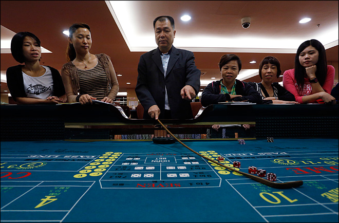 Macau grapples with booming casino economy