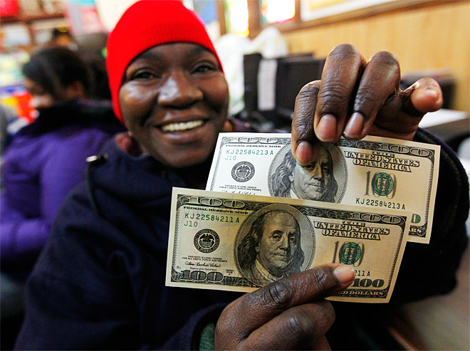 'Secret Santa' showers $100 bills on Sandy victims