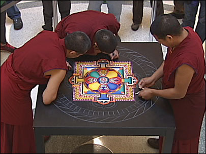 Tibetan monks make a mandala at the library