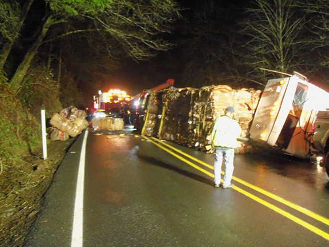 Trucker escapes injury as big rig forced off road crashes into rock wall
