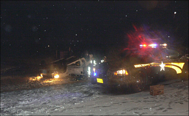 Police: Two killed when truck tries passing a car in the snow