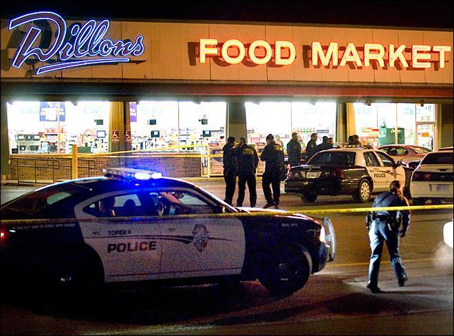 2 Kansas officers fatally shot outside market