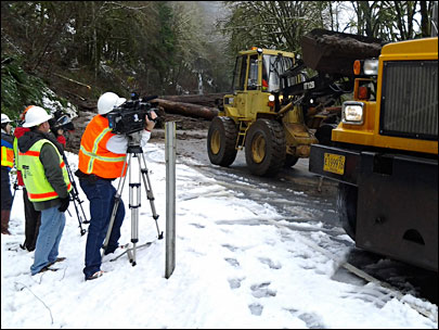 Crews work to clear Hwy 126: 'You can't predict the slides'
