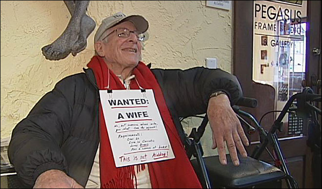Man wears personal ad: 'Wanted: a wife'