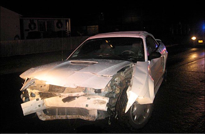 Police: Drunk driver hits parked cars, fences and street sign