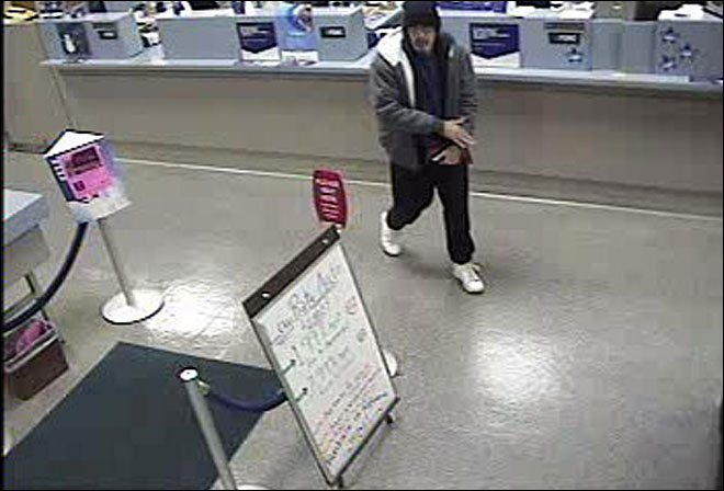 Man with gun robs bank on NYE