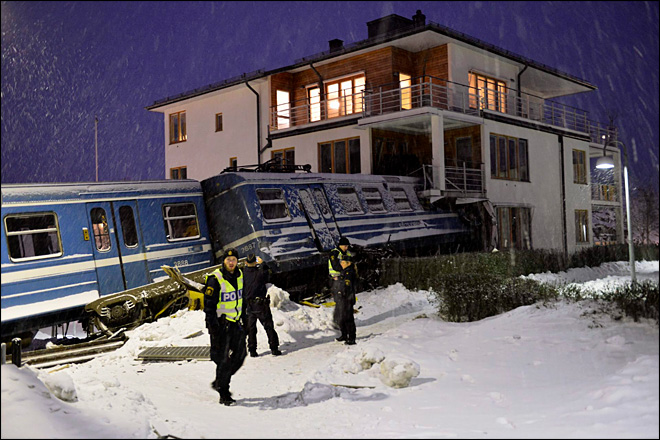 Stolen train crashes into apartment building