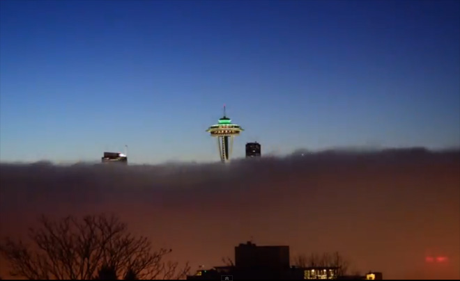 Time lapse video shows Space Needle towering above fog