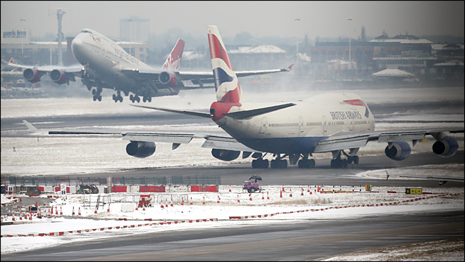 More delays at Heathrow as Britain hit by snow