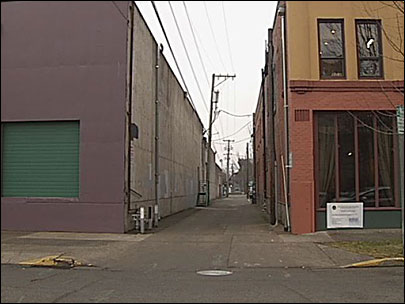 Building owner wants to buy alley across from jail, block access