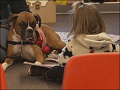 Kids read to dogs at library