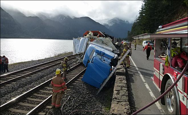 Train vs. truck: Trailer peeled back 'like a can of sardines'