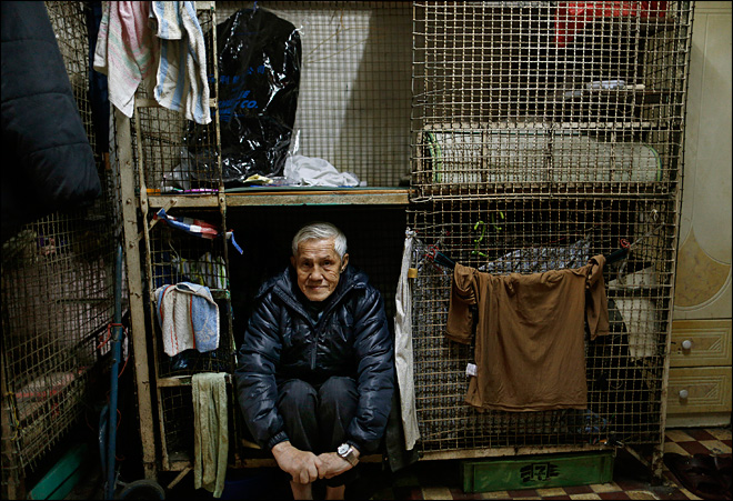 For some poor in Hong Kong, home is a metal cage