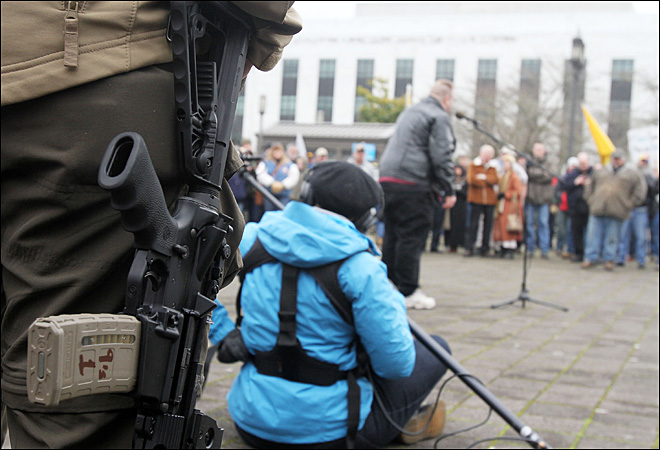 Armed but peaceful, activists pledge to fight new gun laws