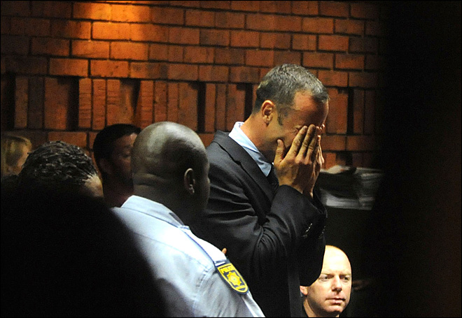 Olympic runner Pistorius breaks down in court over murder charge