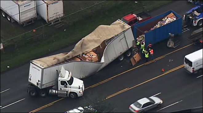 Semi loses axle, snarling traffic heading into Seattle