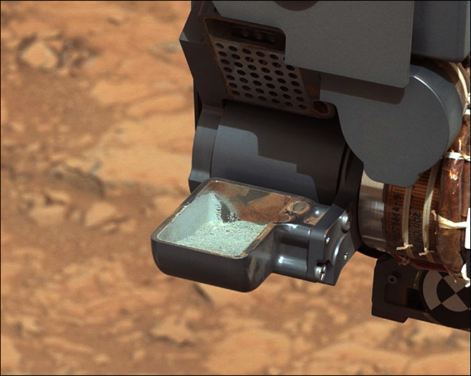 NASA Mars rover analyzing powder from drilled rock