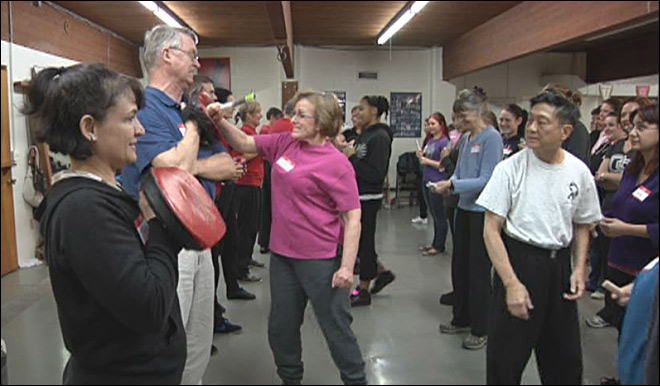 Martial arts master teaches women's self defense course