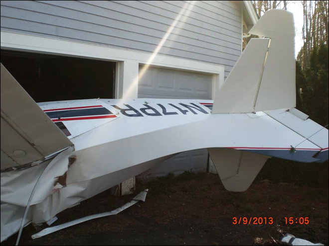 Plane crashes into house