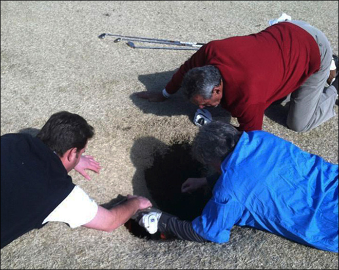 Golfer swallowed by fairway sinkhole