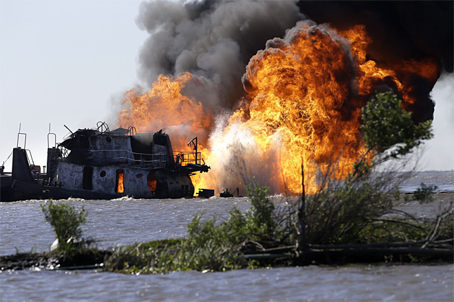 Flames erupt from gas pipeline hit by tug boat pushing oil barge