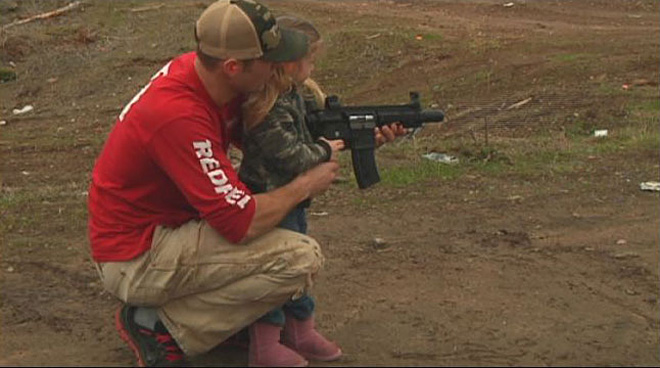 Family day at the gun range: 'She loves them'