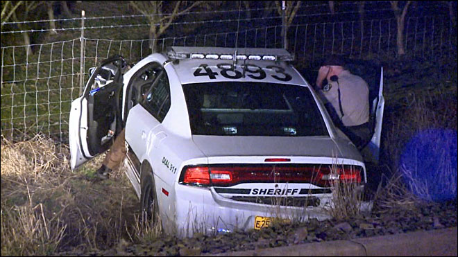 Deputies: Suspect hijacks patrol car, crashes it during chase