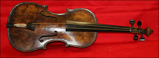Auction house: We found famed Titanic violin