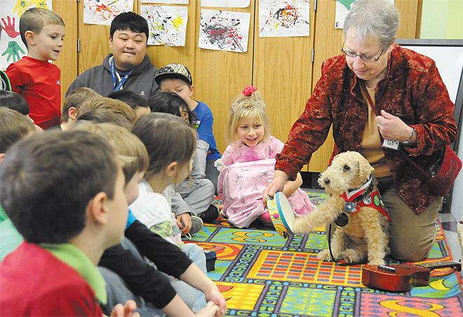 Snuggling Corvallis therapy dog honored for service
