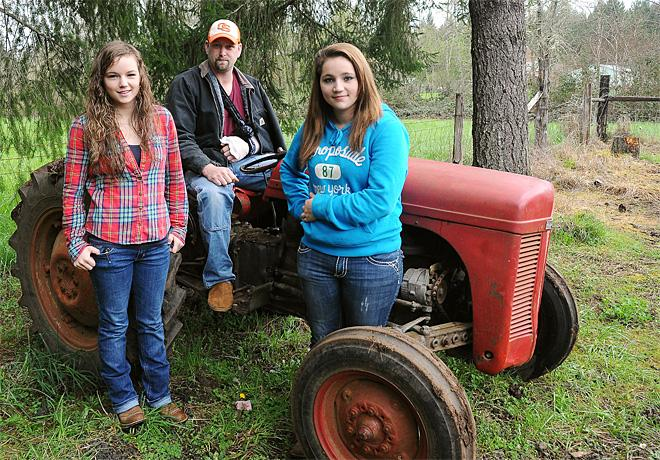 Girls rescue dad by lifting tractor off his chest
