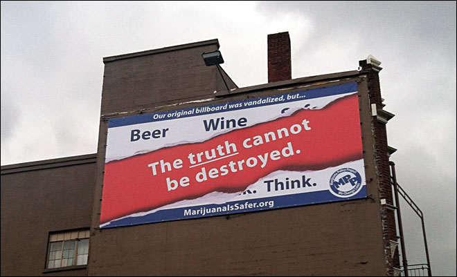 Pro-pot banner goes back up, this time with a different message