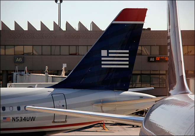 Full planes help boost US Airways 1st quarter results
