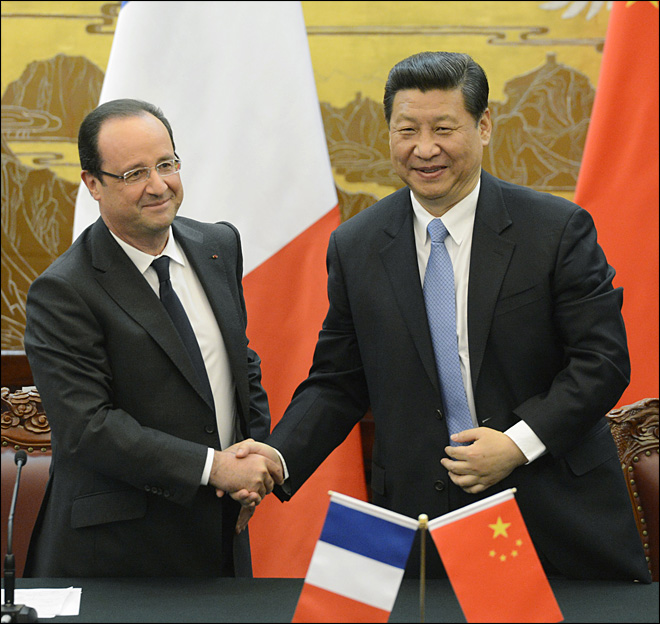 China, France vow to promote world free of any superpower