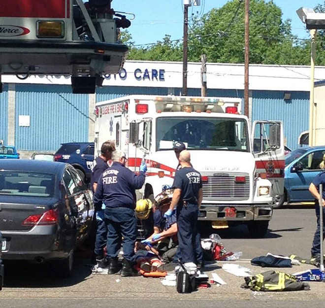 Police, passersby lift car off 'intoxicated' man run over in road