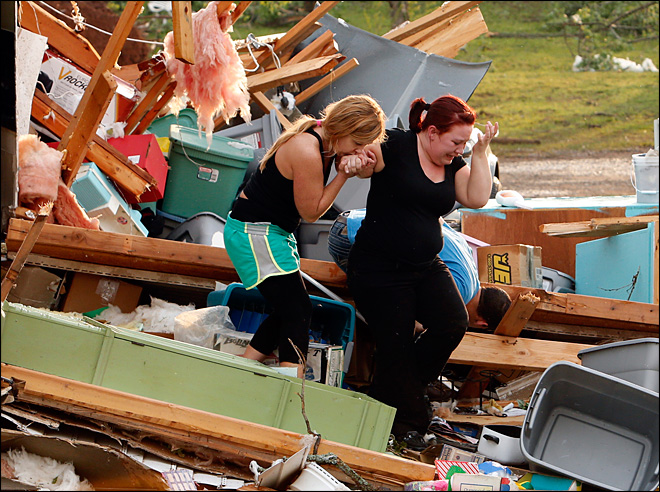 Tornadoes slam Midwest, more in the forecast
