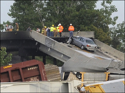 Missouri highway buckles after rail cars hit overpass