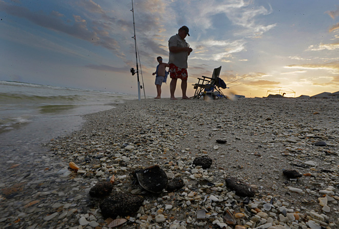 End of BP cleaning crews leaves questions on Gulf Coast
