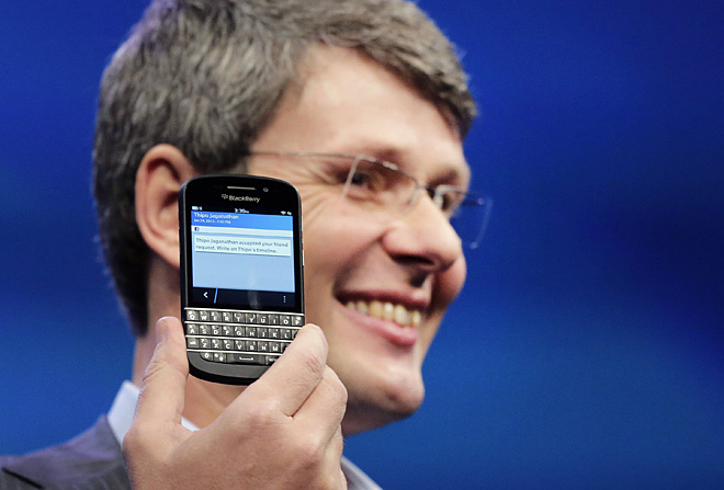 Blackberry-maker RIM posts larger-than-expected loss, shares plunge