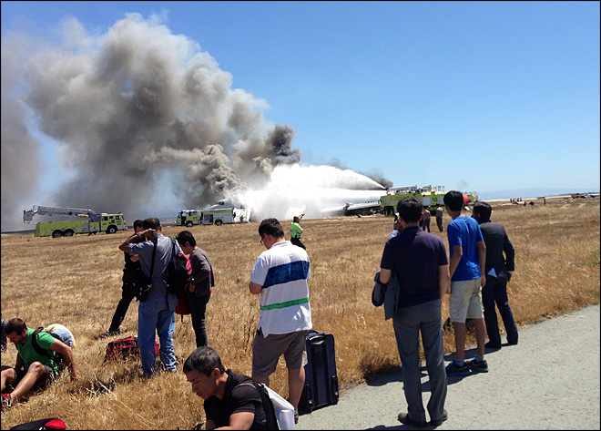 NTSB: Asiana pilot initially said not to evacuate plane after SF crash