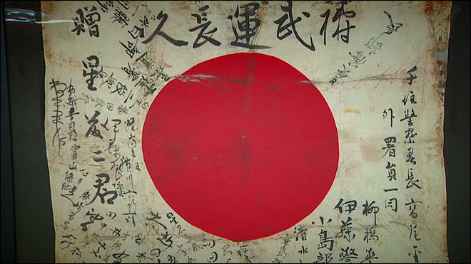 Tattered World War II flag brings two families together