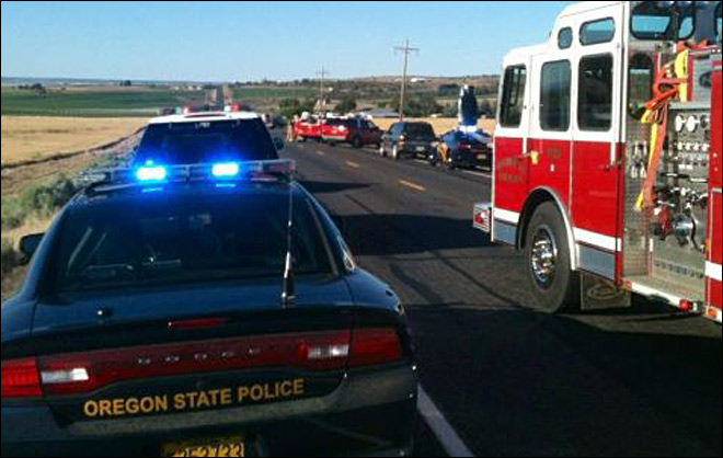 2 dead, 1 hurt in head-on crash along Hwy 97