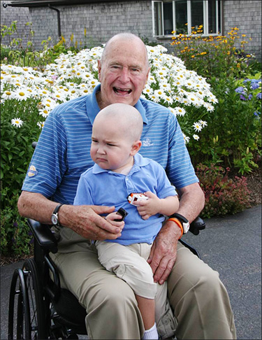 George H.W. Bush shaves head to support child with cancer