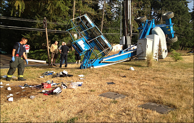 Boom lift tips over on S. Eugene hill, man sent to the hospital