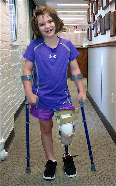7-year-old Boston bomb survivor using new prosthetic leg