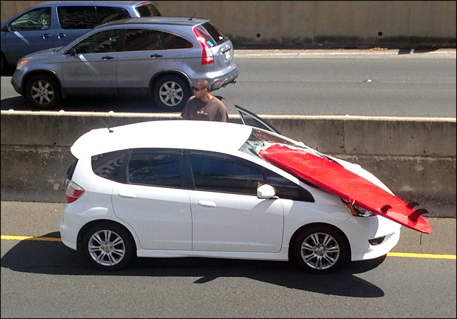 Surfboard pierces Honolulu driver's windshield