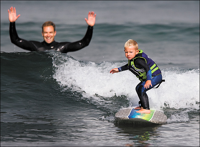 Age 3, hanging 10: Preschooler surfer is a natural