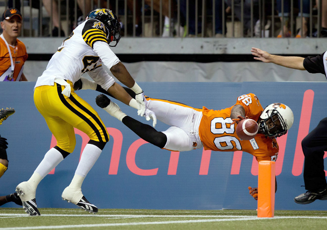 APTOPIX Tiger Cats Lions Football
