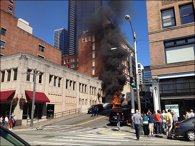 Car erupts in flames after crash in downtown Seattle